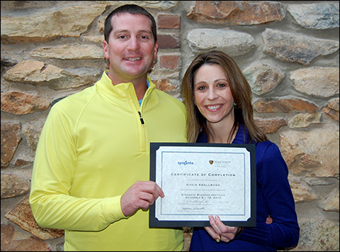 David Smallwood (left) receives his certificate of completion for the Syngenta Business Institute from Stephanie Schwenke (right), the company's golf market manager.